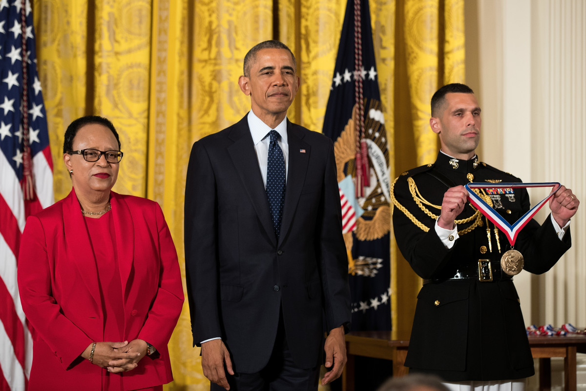 Dr. Shirley Jackson stands with President Barack Obama before receiving the National Medal of Science