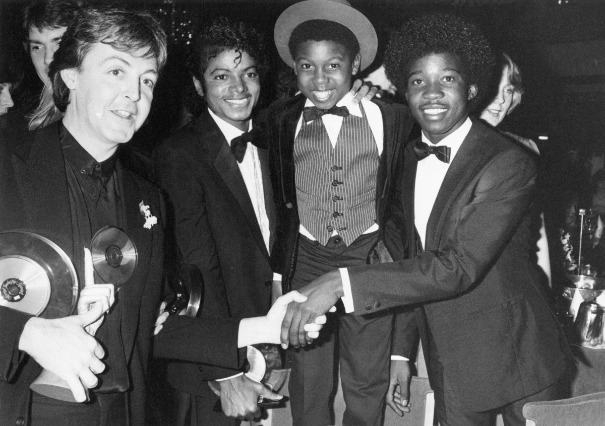 Paul McCartney poses with Michael Jackson, Michael Grant and Junior Waite of Musical Youth at the British Record Industry Awards in February 1983.