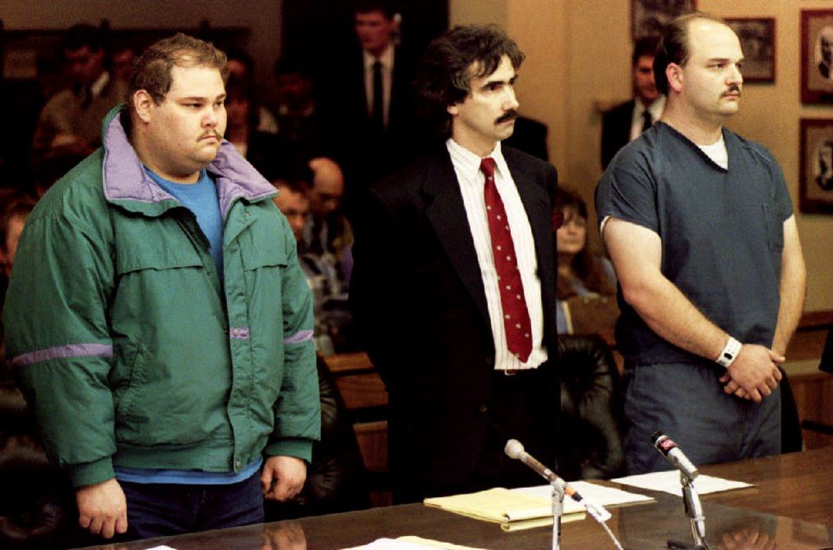 Shawn Eckardt, bodyguard of figure skater Tonya Harding, and Derrick Smith are joined by Smith's attorney during their arraignment on charges of conspiracy to commit assault in the attack on skater Nancy Kerrigan