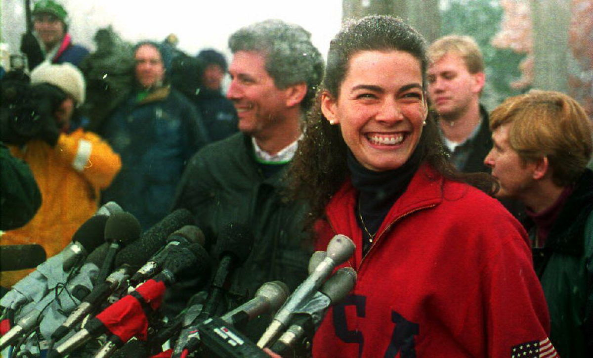 Nancy Kerrigan, joined by her family and agent, answers questions from the press outside her parents Stoneham, Massachusetts home January 14, 1994.