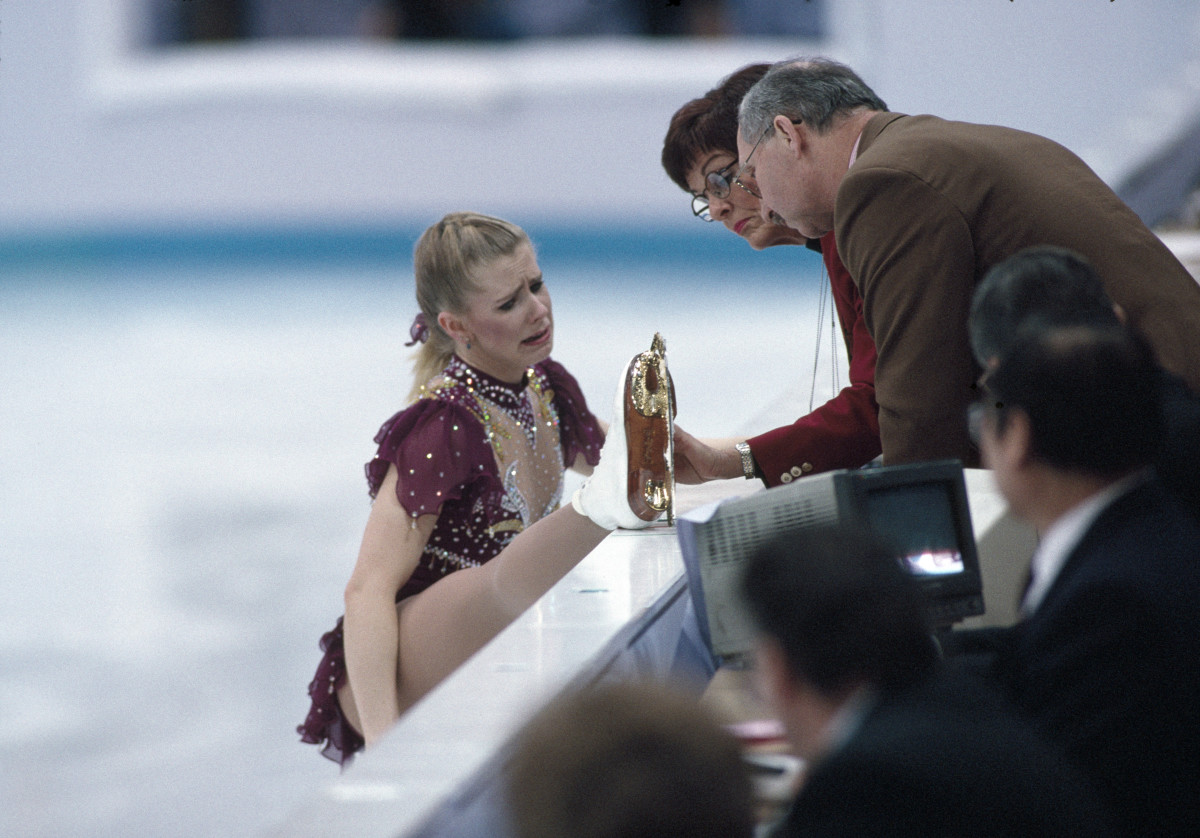 Tonya Harding of the United States discussing a snapped lace on her boot with the judges during the ladies skating event at the Winter Olympic Games in Lillehammer, Norway