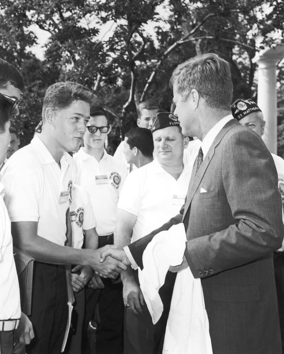 Bill Clinton, a teenage boy, shakes the hand of President John F. Kennedy