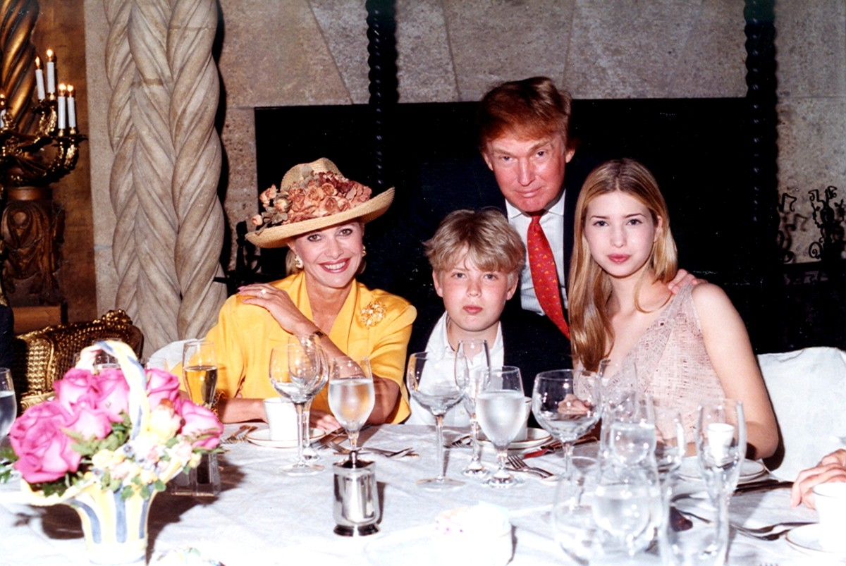 Ivana Trump, Eric Trump, Donald Trump, and Ivanka Trump as they sit at a table at the Mar-a-Lago in 1998