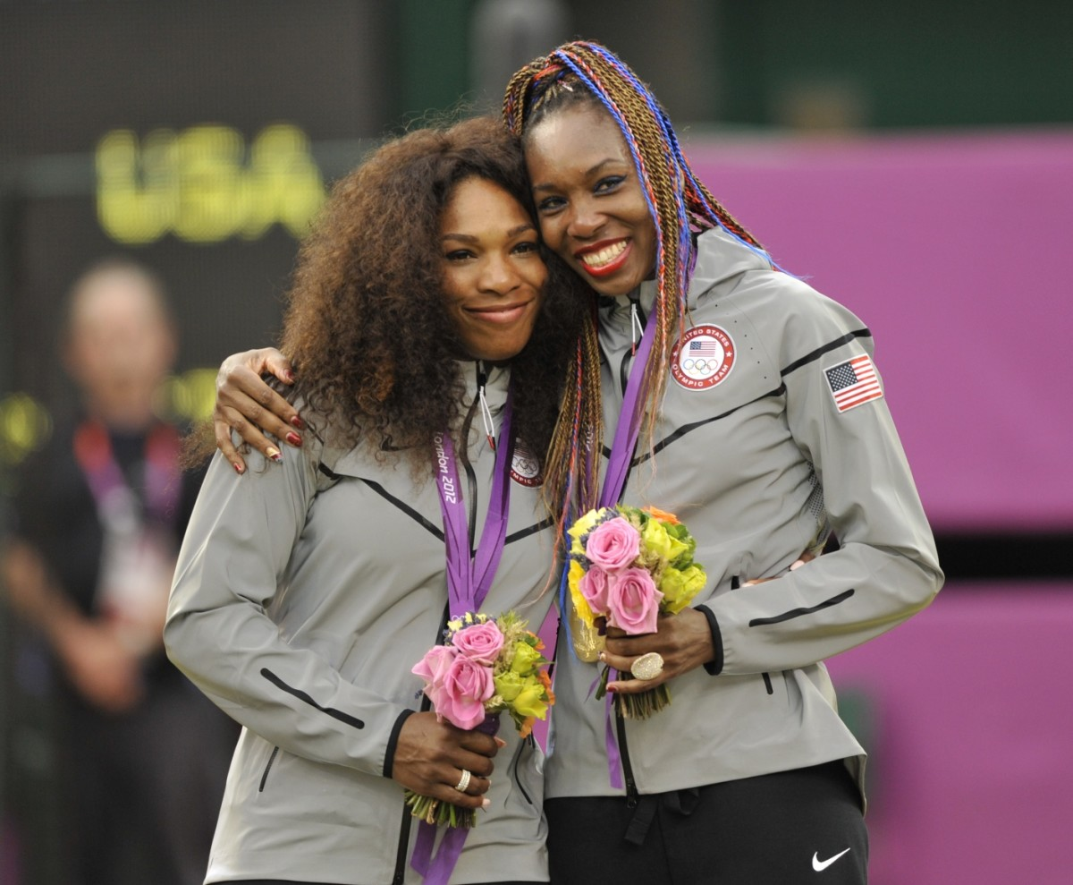 Serena and Venus Williams after winning the Women's Doubles gold medal at the London Olympics in 2012