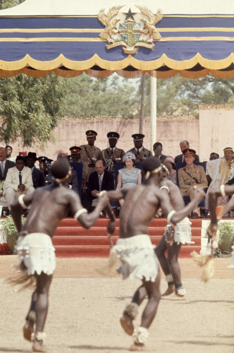 Queen Elizabeth II watches a dance performance in an outdoor parade ground, Tamale, Ghana, November 12, 1961