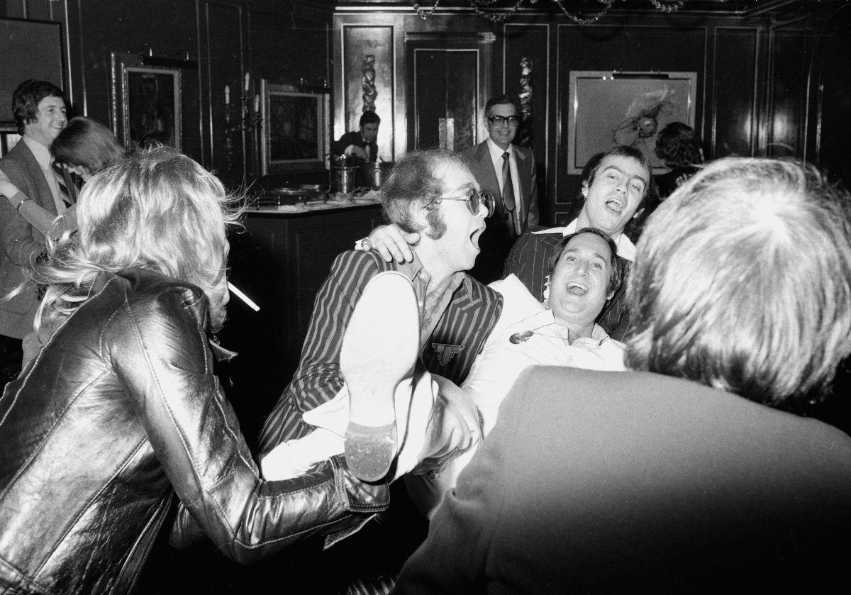 Elton John, Neil Sedaka and Bernie Taupin partying in London, England in 1975