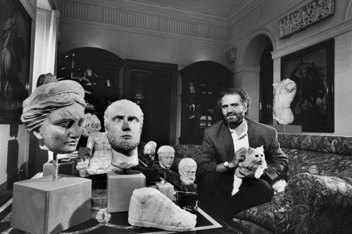 Gianni Versace at home with his sculpture collection
