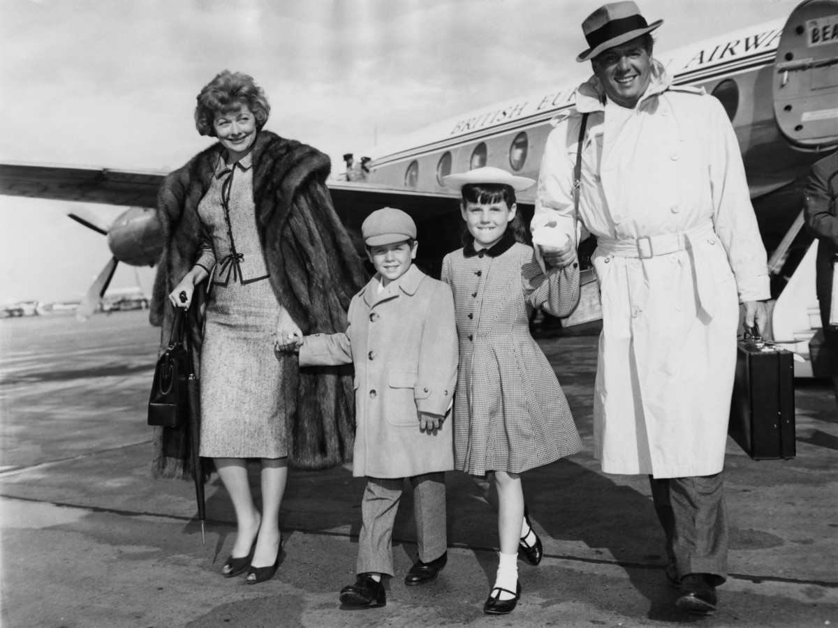 Lucille Ball and her husband Desi Arnaz arrive at London Airport with their children Lucie and Desi Jr