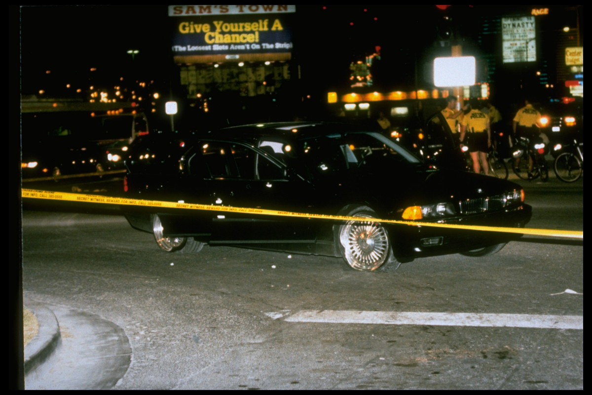Black car in which rapper Tupac Shakur was fatally shot by unknown driveby assassins as he was riding w. friend Death Row records. pres. Marion Suge Knight, who survived shooting, behind police tape at crime scene