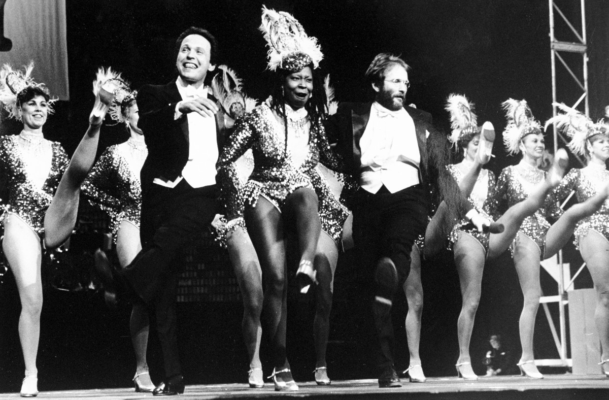 Billy Crystal, Whoopi Goldberg and Robin Williams dancing with the Rockettes