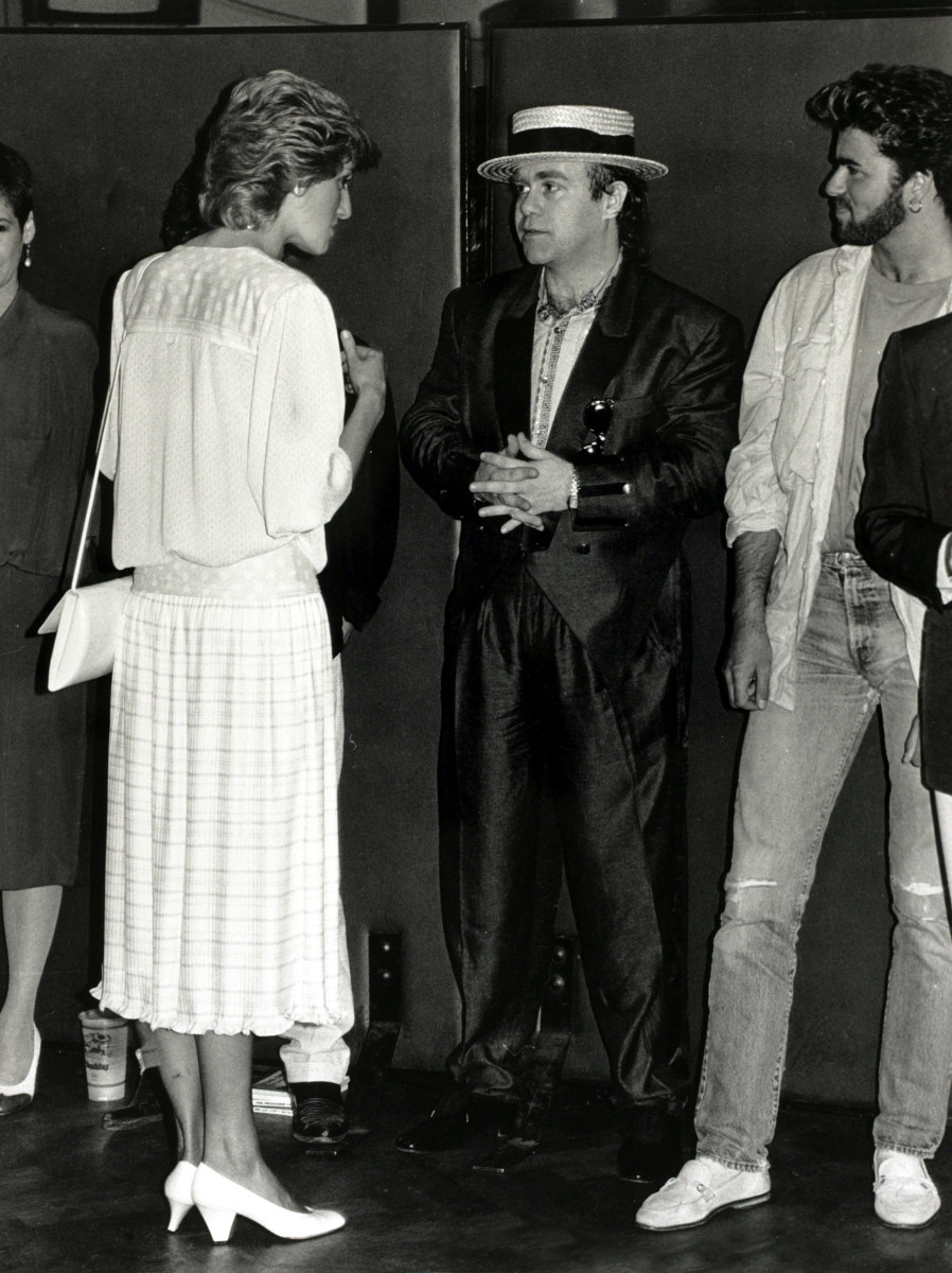 Princess Diana chatting with Elton John and George Michael at the Feed the World Live Aid concert in July 1985