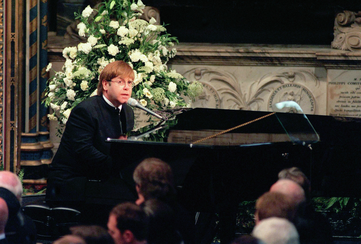 "Elton John singing ""Candle in the Wind"" at Princess Diana's funeral at Westminster Abbey on September 6, 1997"