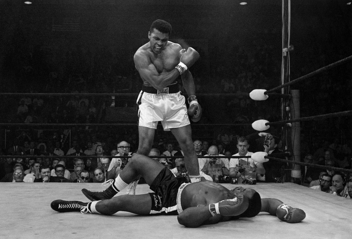 Muhammad Ali stands over Sonny Liston after dropping Liston with a short hard right to the jaw on May 25, 1965, in Lewiston, Maine