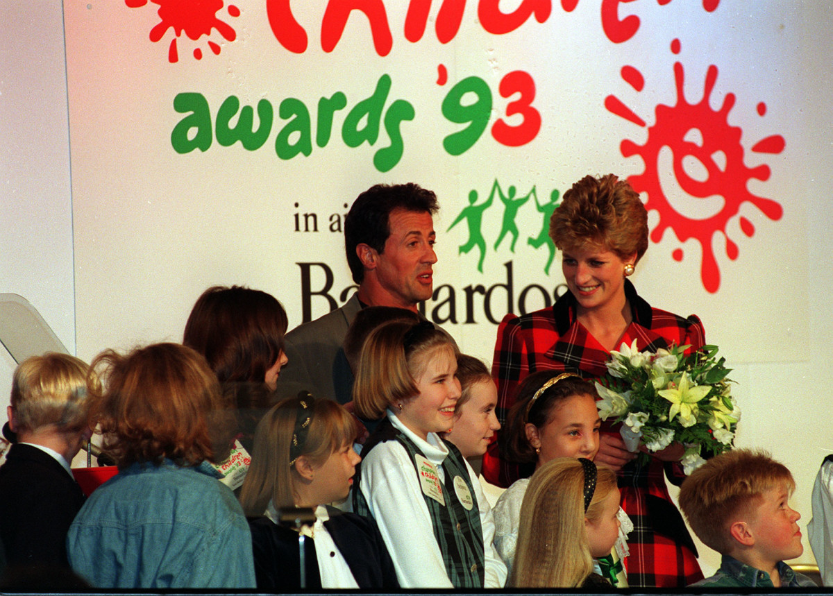 Princess Diana chats with Sylvester Stallone at the Champion Children Awards held at London's Dorchester Hotel.