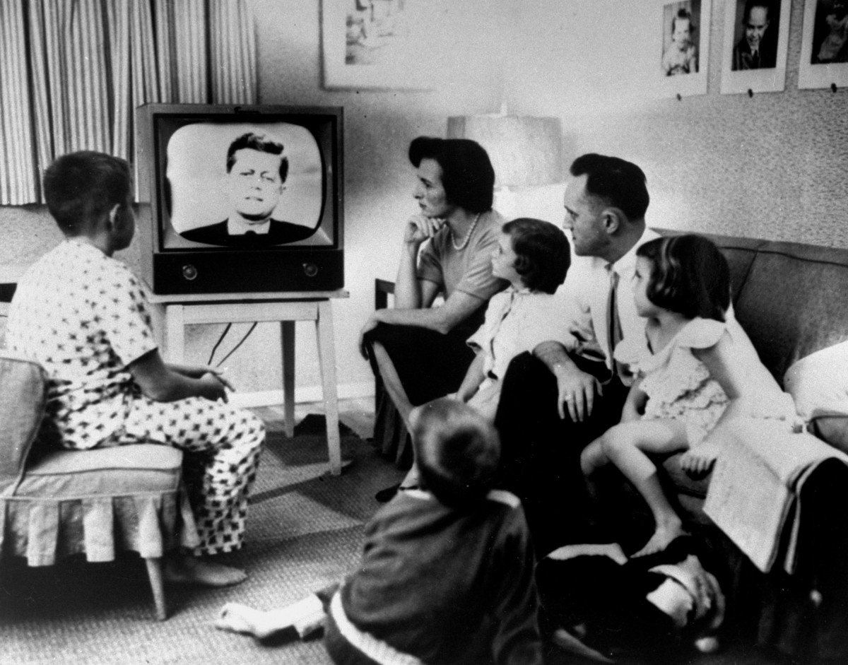A family gathered around the TV while watching the Kennedy-Nixon debate