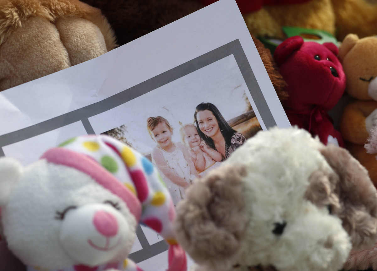 A photograph of Shan'ann Watts and her two daughters, Bella and Celeste, in a sea of mementos outside the Watts' Colorado home