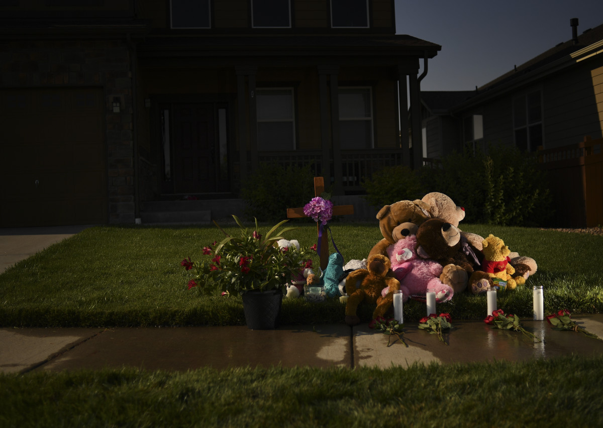 A memorial for Shan'ann, Bella and Celeste Watts outside the family home on August 16, 2018, in Frederick, Colorado