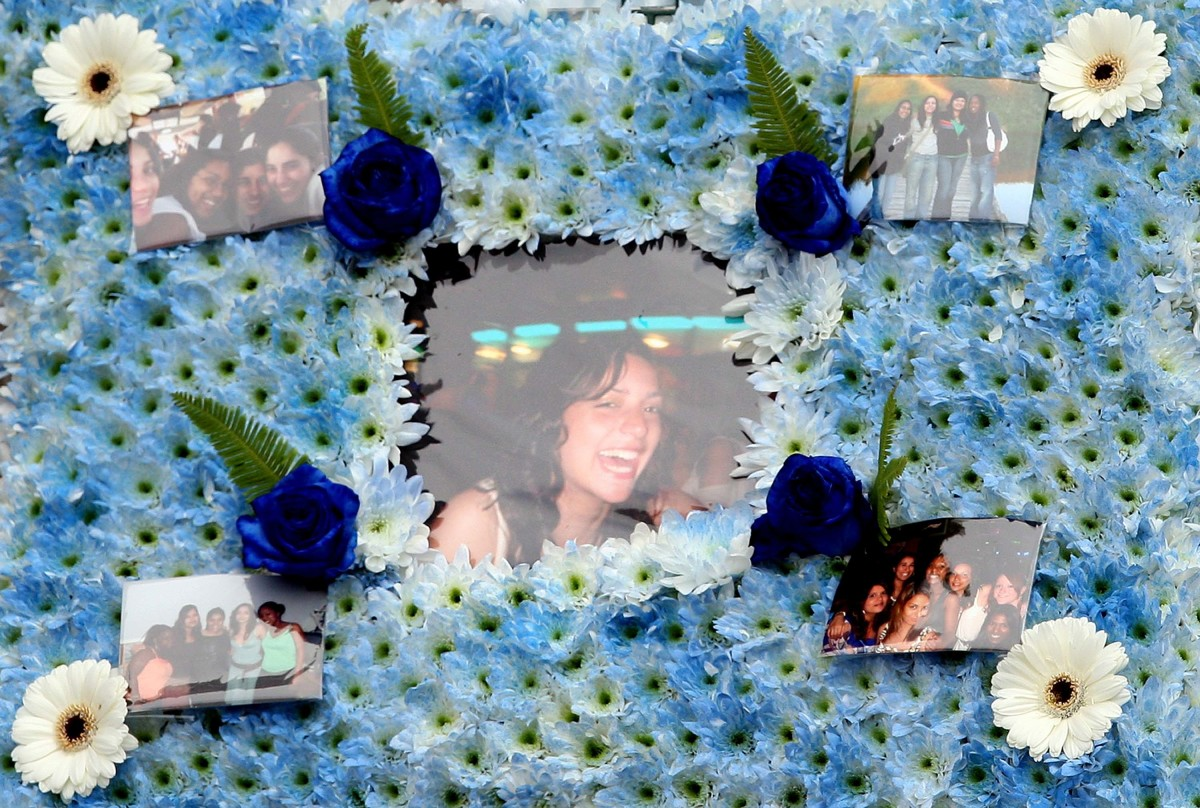 A floral tribute with photographs of Meredith Kercher