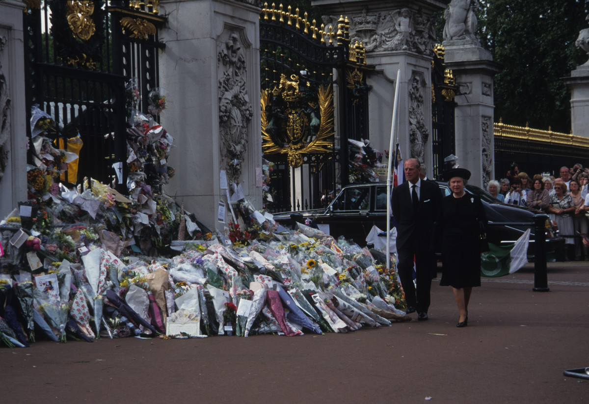 Queen Elizabeth II and Prince Philip, walk by the public tributes to the late Princess Diana on September 6, 1997