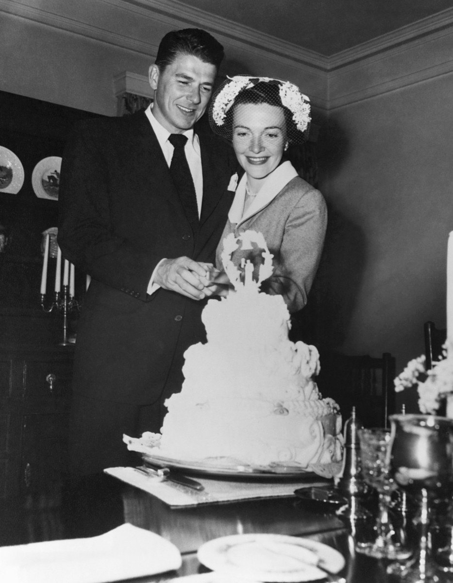 Ronald and Nancy Reagan cutting the cake at their wedding on March 4, 1952
