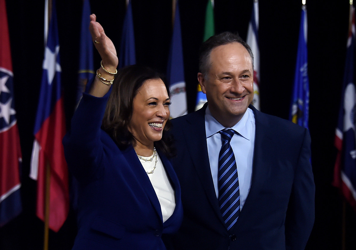 Kamala Harris and her husband, Douglas Emhoff, pose on stage after the first Biden-Harris press conference in Wilmington, Delaware, on August 12, 2020