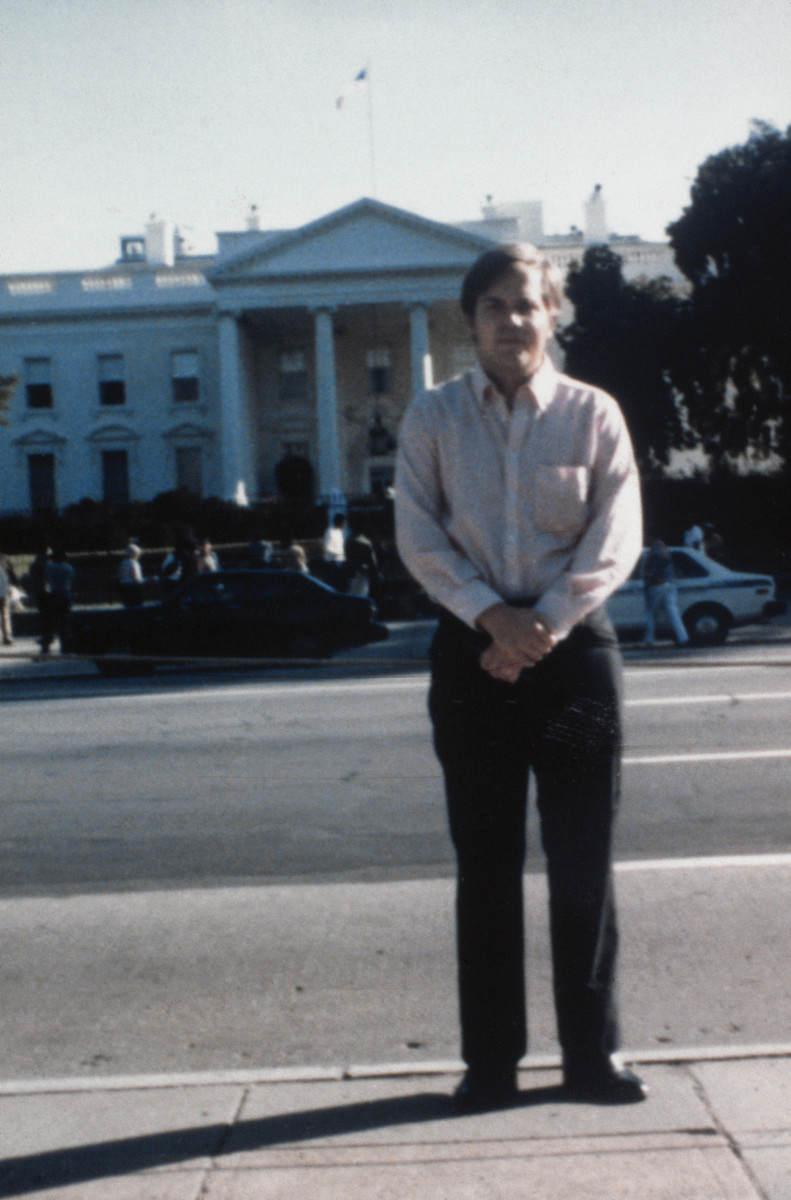 John Hinckley Jr., the man attempted to assassinate President Ronald Reagan in 1981, stands in front of the White House