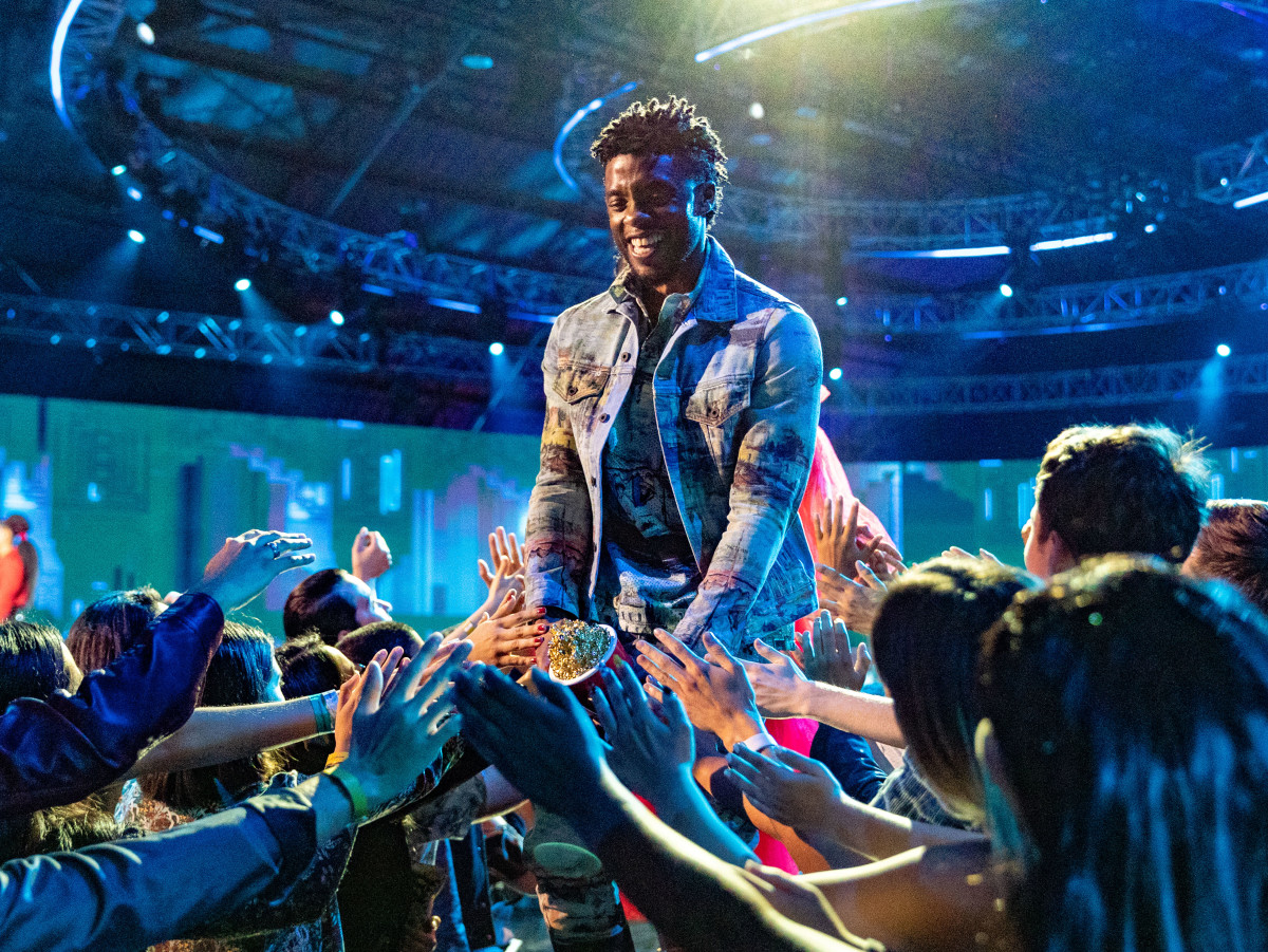"""Chadwick Boseman accepts the Best Performance in a Movie award for """"Black Panther"""" at the 2018 MTV Movie And TV Awards at Barker Hangar in Santa Monica, California on June 16, 2018"""