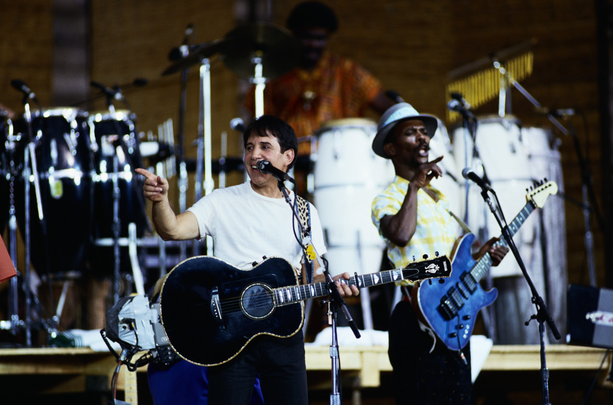 "Paul Simon performs on stage during a tour to promote his ""Graceland"" album, February 1987"