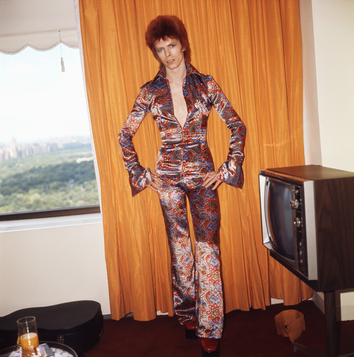 David Bowie poses for a portrait dressed as Ziggy Stardust in a hotel room in New York City, 1973