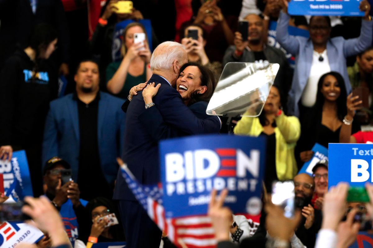 Kamala Harris hugs Joe Biden after she endorsed him at a campaign rally at Renaissance High School in Detroit, Michigan on March 9, 2020