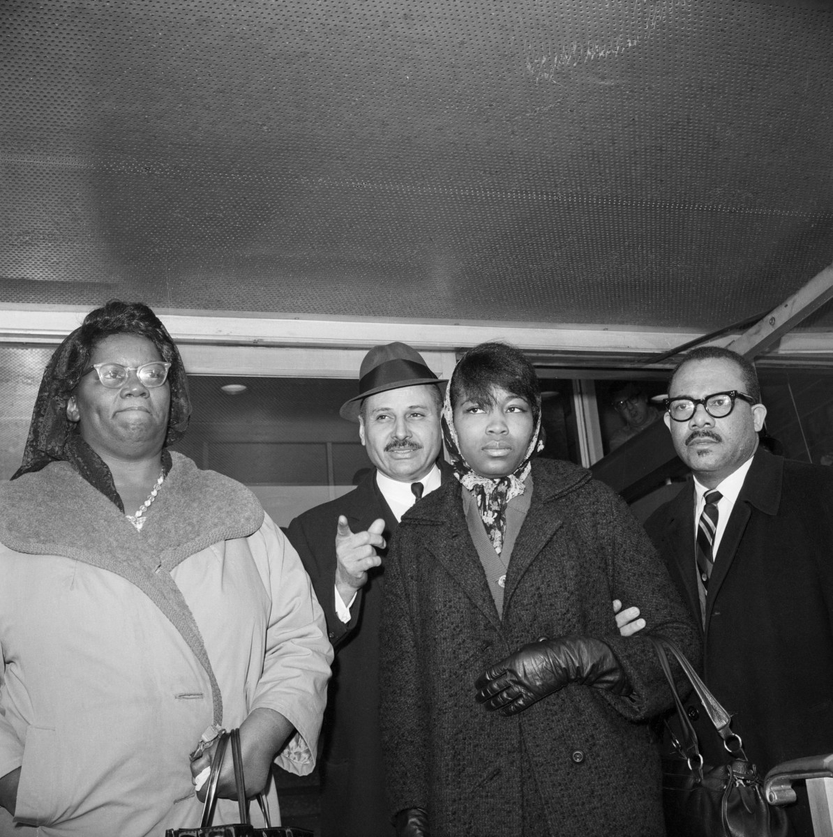 Betty Shabazz leaves the morgue at Bellevue Hospital in New York after identifying the body of her husband, Malcolm X, February 22, 1965
