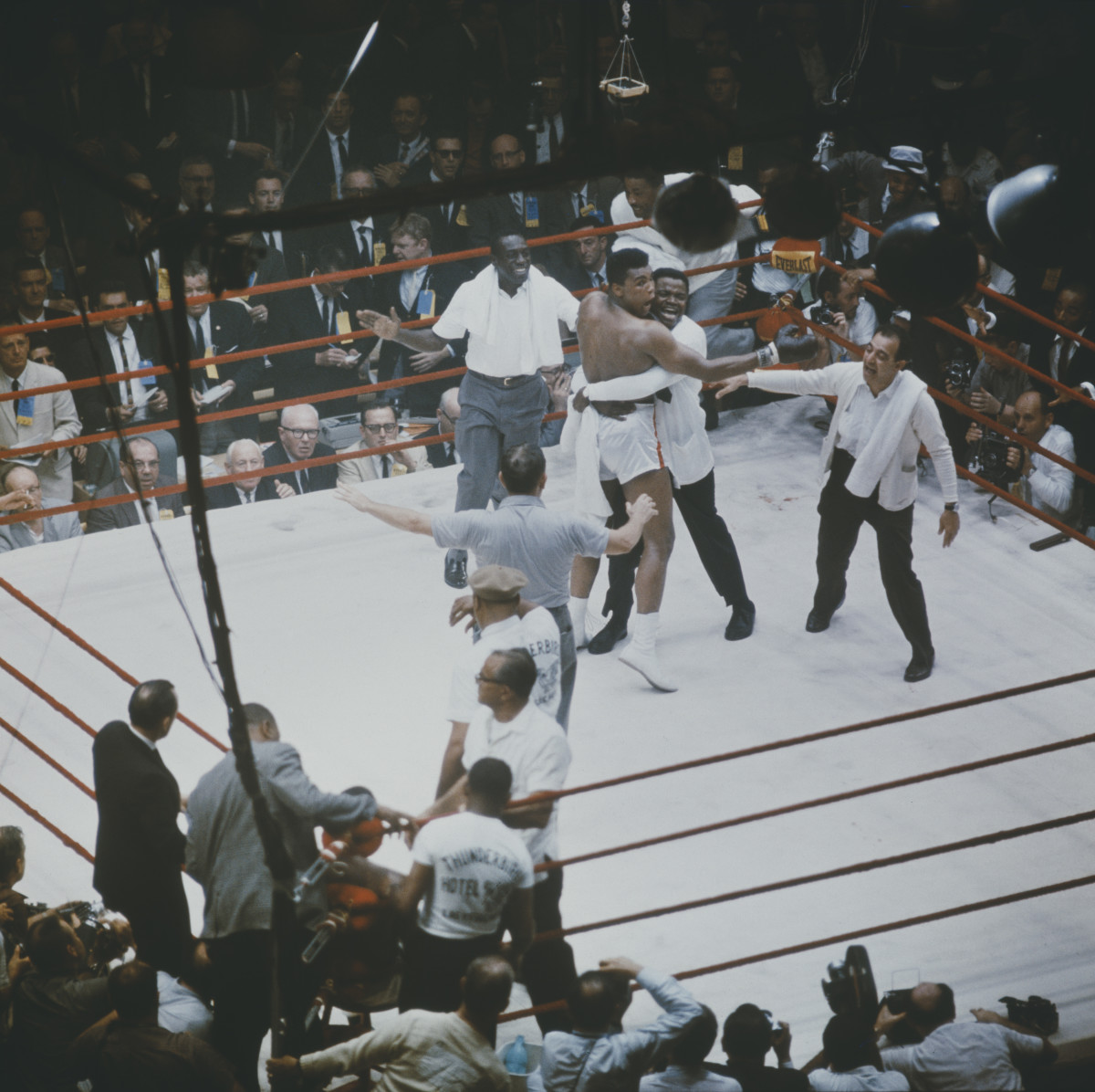 Muhammad Ali is congratulated by his cornerman, Drew Bundini Brown and trainer Angelo Dundee (right) after beating Sonny Liston to become the Heavyweight Champion of the World in Miami Beach, Florida on February 25, 1964