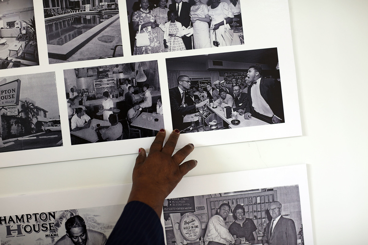 A photograph of Malcolm X and Mohammad Ali at the counter in the Hampton House Motel