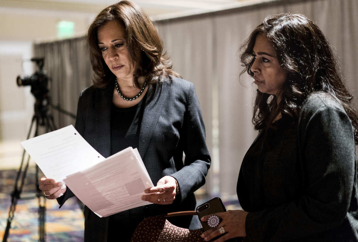 Kamala Harris with sister and advisor, Maya Lakshmi Harris (right), prepares to speak to women of color in a packed banquet room during the Black Enterprise Women of Power Summit at The Mirage in Las Vegas, Nevada on March 1, 2019