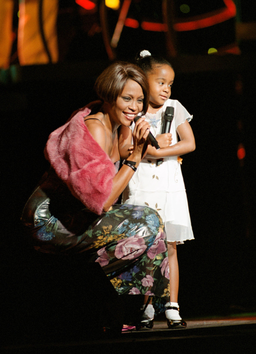 Whitney Houston on stage with her daughter, Bobbi Kristina Brown, during a concert on July 16, 1999, in New York, New York