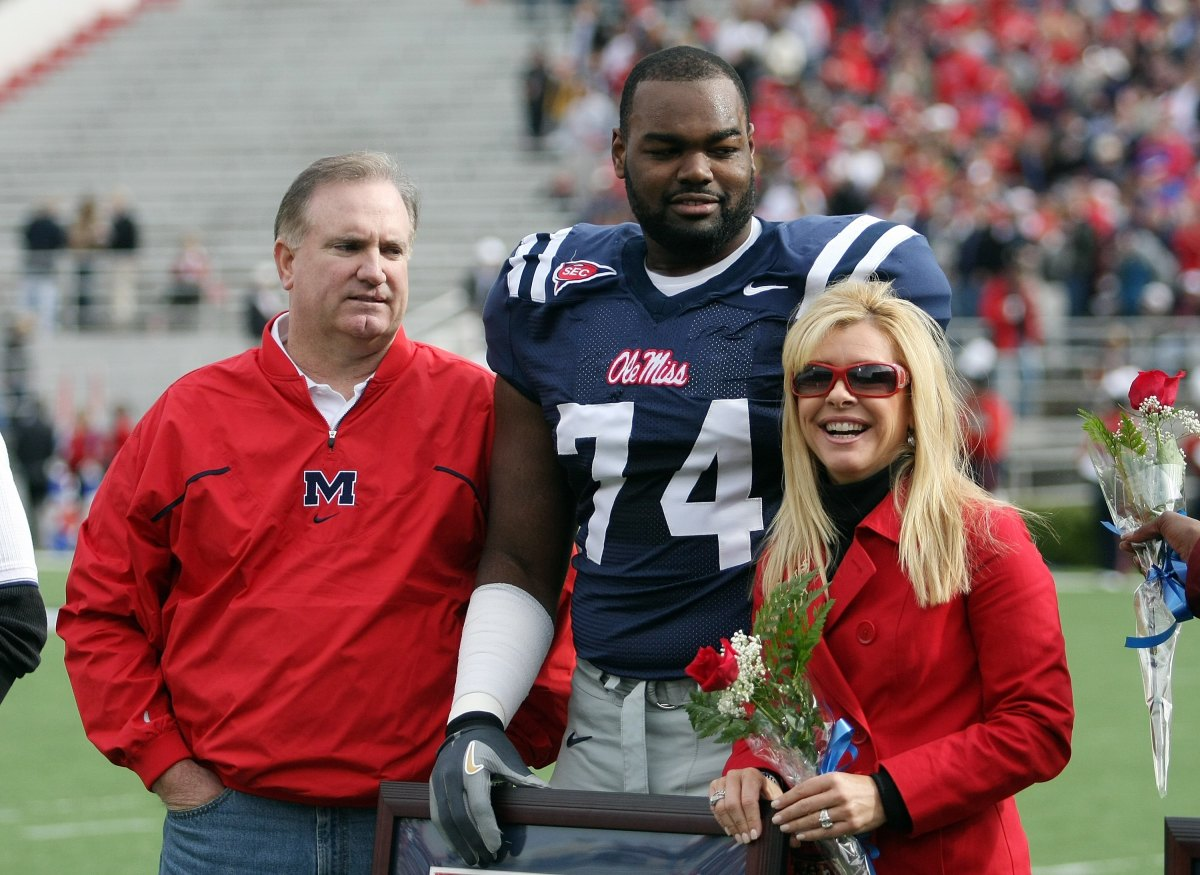 Michael Oher stands with his family during senior ceremonies prior to a game against the Mississippi State Bulldogs at Vaught-Hemingway Stadium on November 28, 2008, in Oxford, Mississippi.