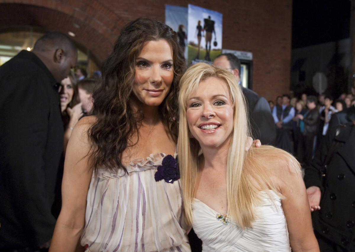 "Sandra Bullock with Leigh Anne Tuohy at ""The Blind Side"" benefit premiere at the Prytania Theatre on November 19, 2009, in New Orleans, Louisiana"