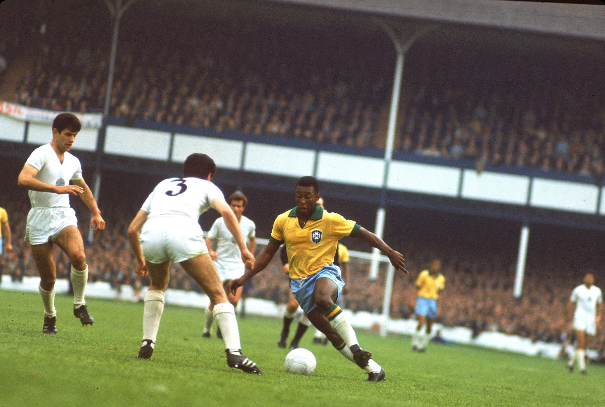 Pele (center, in yellow jersey) on the ball for Brazil during a group stage match against Bulgaria at Goodison Park during the 1966 World Cup tournament in Liverpool, England