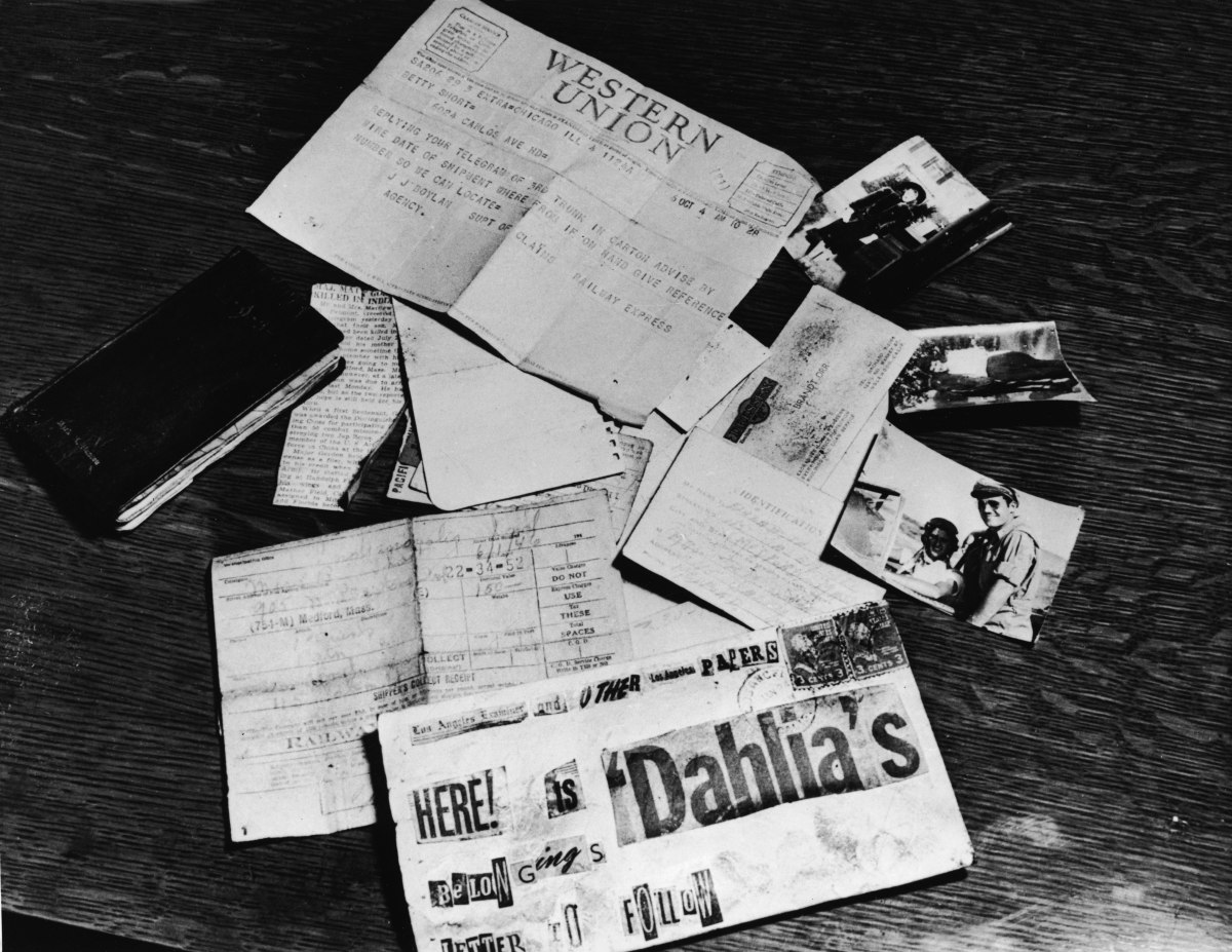 Evidence concerning the murder Elizabeth Short strewn across a table at the Los Angeles District Attorney's office, Los Angeles, California, 1947