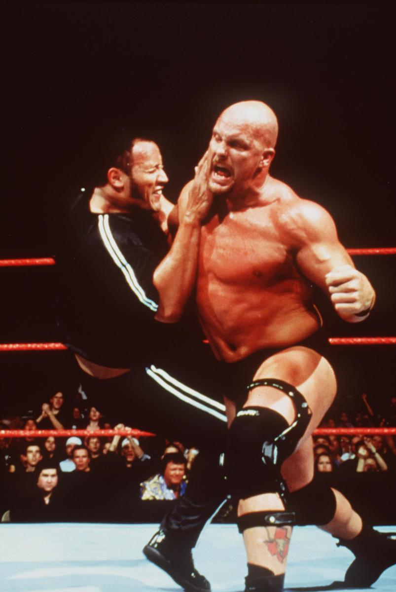"""The Rock and """"Stone Cold"""" Steve Austin during a smackdown"""