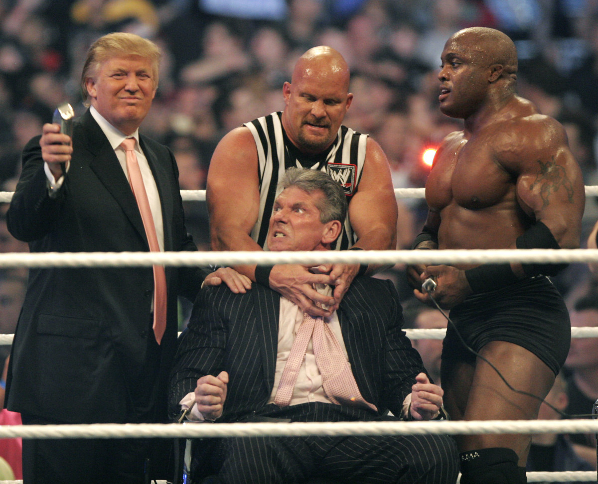 """Vince McMahon (C) prepares to have his head shaved by Donald Trump (L) and Bobby Lashley (R) while being held down by ''Stone Cold'' Steve Austin after losing a bet in the """"Battle of the Billionaires"""" at WrestleMania at Ford Field on April 1, 2007, in Detroit, Michigan"""
