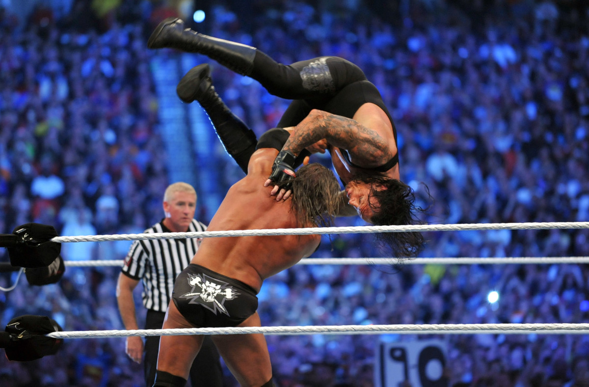 Triple H and the Undertaker battle during WrestleMania 27 at the Georgia World Congress Center in Atlanta, Georgia on April 3, 2011