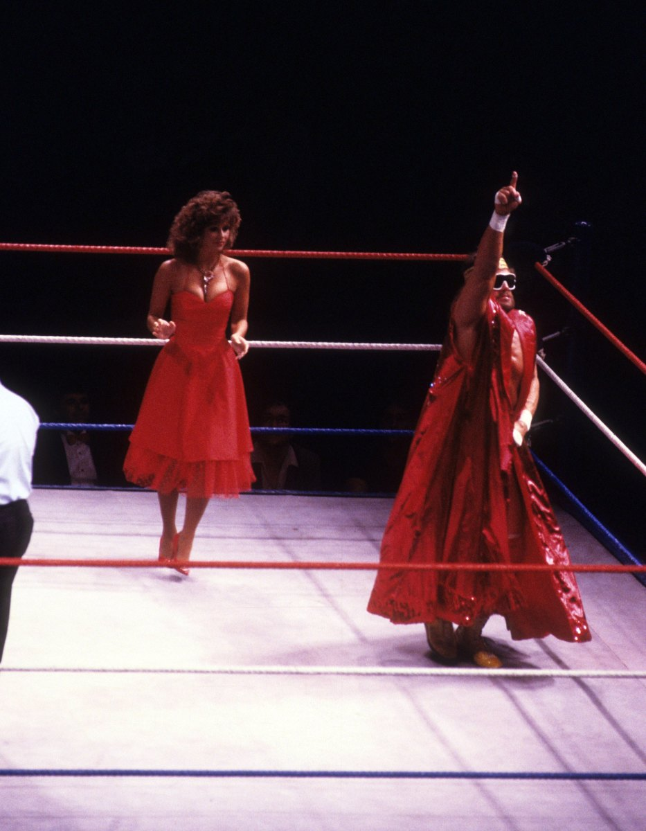 """""""Macho Man"""" Randy Savage enters the ring with Miss Elizabeth before a 1987 WWF match against Sika at Madison Square Garden in New York City"""