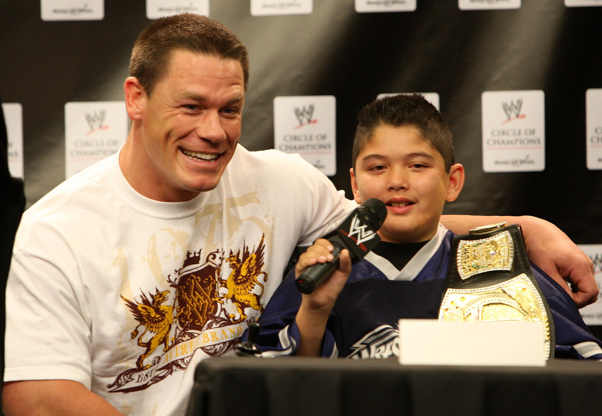 John Cena and Make-A-Wish foundation special guest Max, speaks at the WWE and Make-A-Wish partnership announcement at U.S. Airways Center in Phoenix, Arizona on February 26, 2008