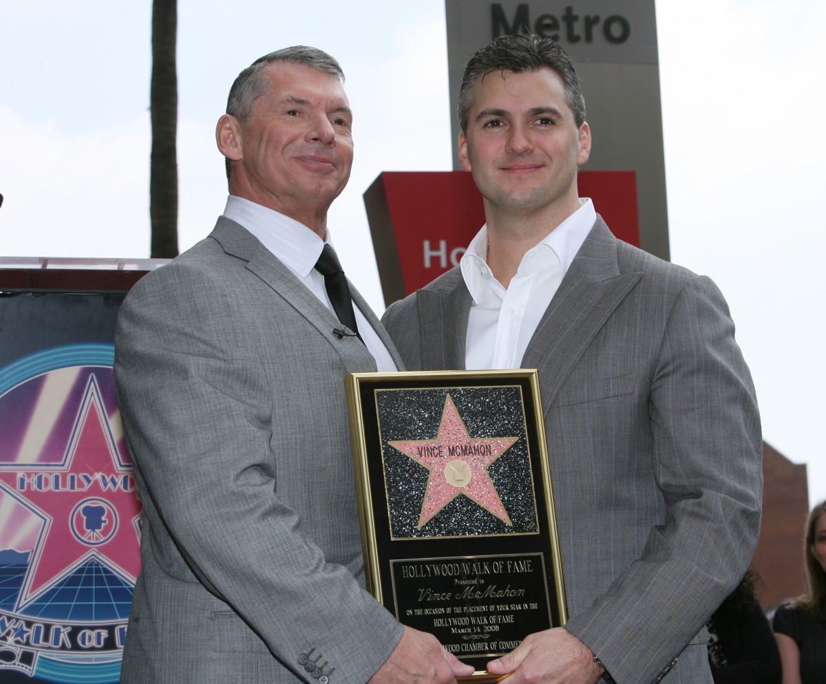 Vince McMahon and son Shane McMahon at the 2,357th Star on the Hollywood Walk of Fame ceremony honoring Vince McMahon held on Hollywood Blvd on March 14, 2008, in Hollywood, California