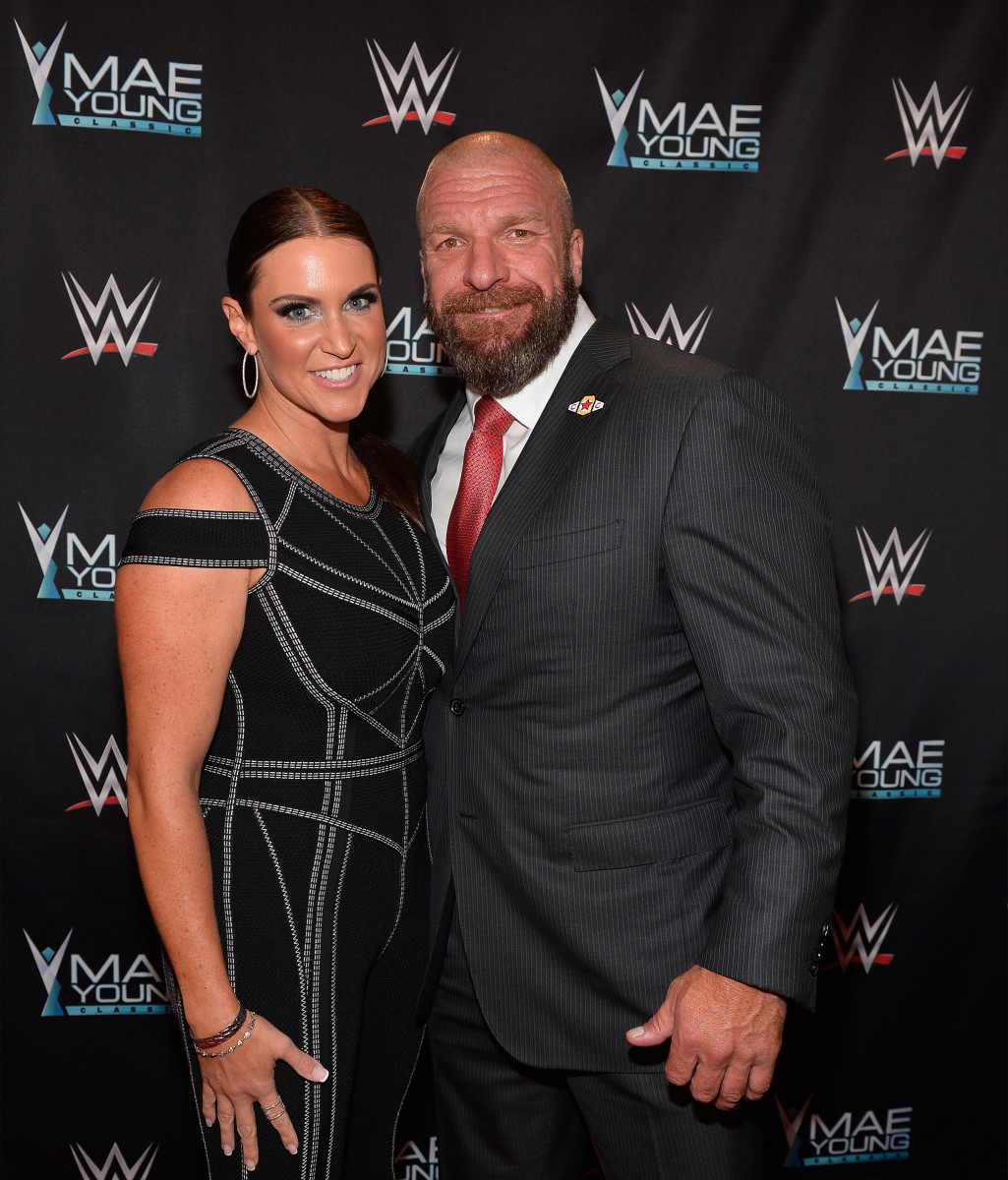 "Stephanie McMahon (L) and husband Paul ""Triple H"" Levesque at the WWE Mae Young Classic on September 12, 2017, in Las Vegas, Nevada"