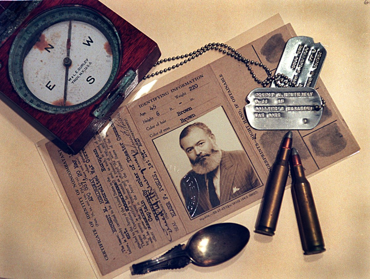 Ernest Hemingway's dog tags, WWII war correspondents credential, baby spoon, hunting bullets and compass