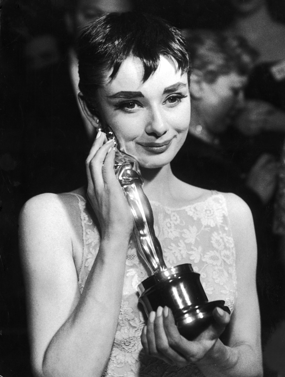 Audrey Hepburn holding the Oscar she won for her performance in the 'Roman Holiday'