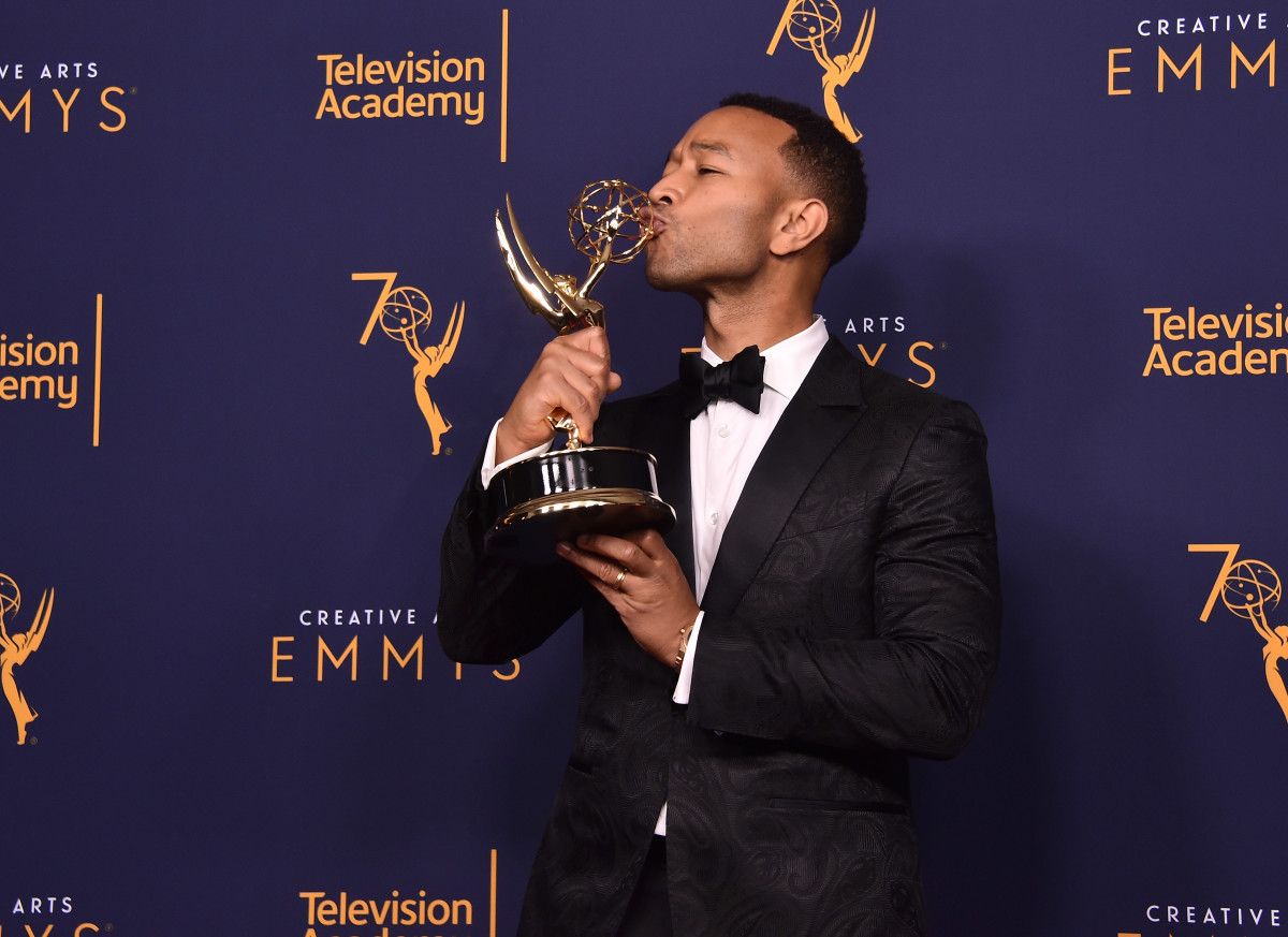 John Legend poses with his Emmy at Microsoft Theater on September 9, 2018 in Los Angeles, California.