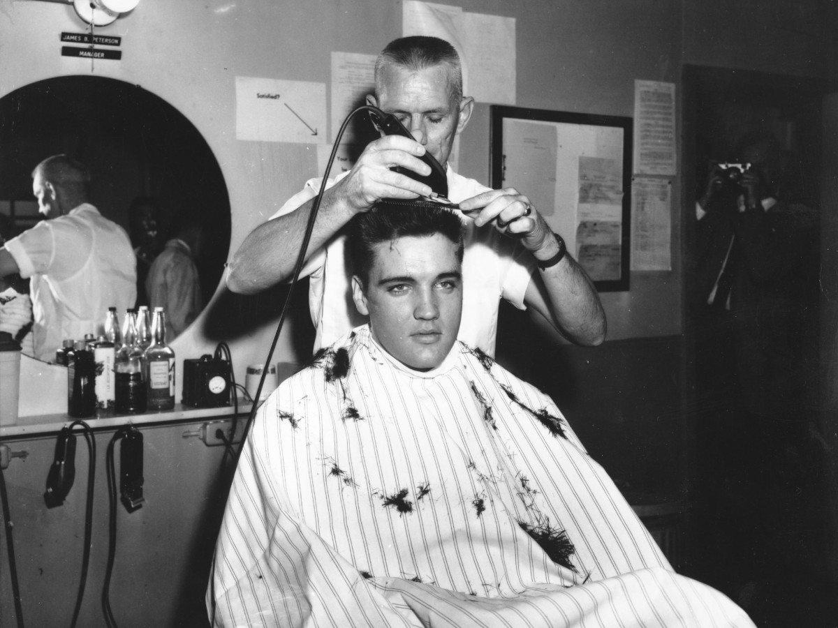 Elvis Presley gets his hair shorn off in preparation for his tour of duty in in the United States Army